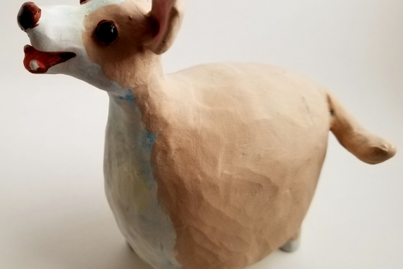 Tan and White Happy Dog Sculpture