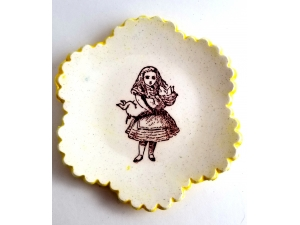 Tiny Plate Alice in Wonderland holding a pig!
